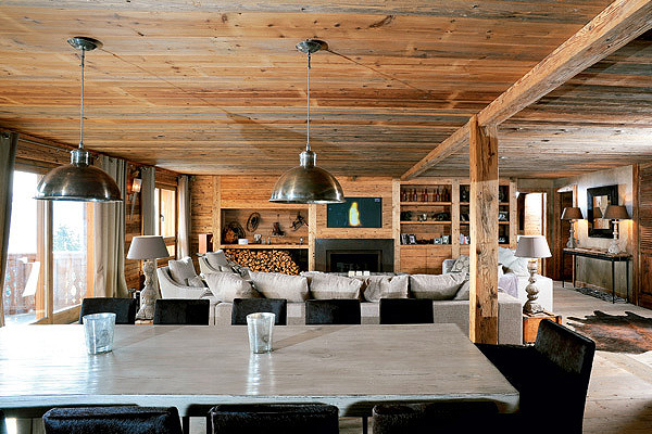 Designer Marina Wenger created this interior of chalet in the Swiss Alps  with emphasis on antique wood and concrete surfaces.
